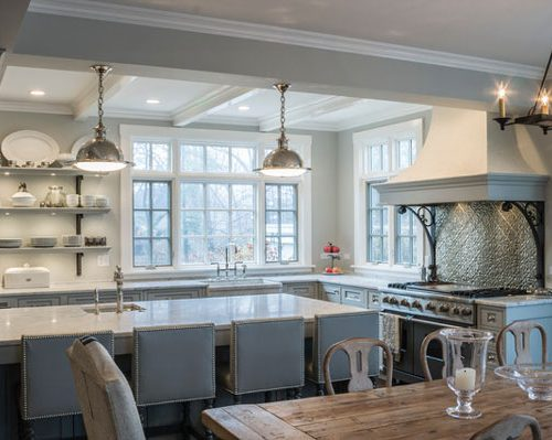 wrought iron corbels blue and white traditional kitchen boston cabinet cures